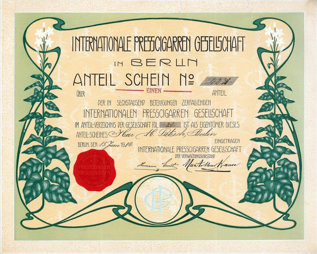 Internationale Presscigarren Gesellschaft, Berlin, Anteilschein von 1904. Das haben wir noch nie bei einem Wertpapier gesehen: Die Umrahmung einschließlich der Tabakpflanzen und ihrer Blüten ist erhaben geprägt, eine tolle und ganz einmalige Gestaltung!