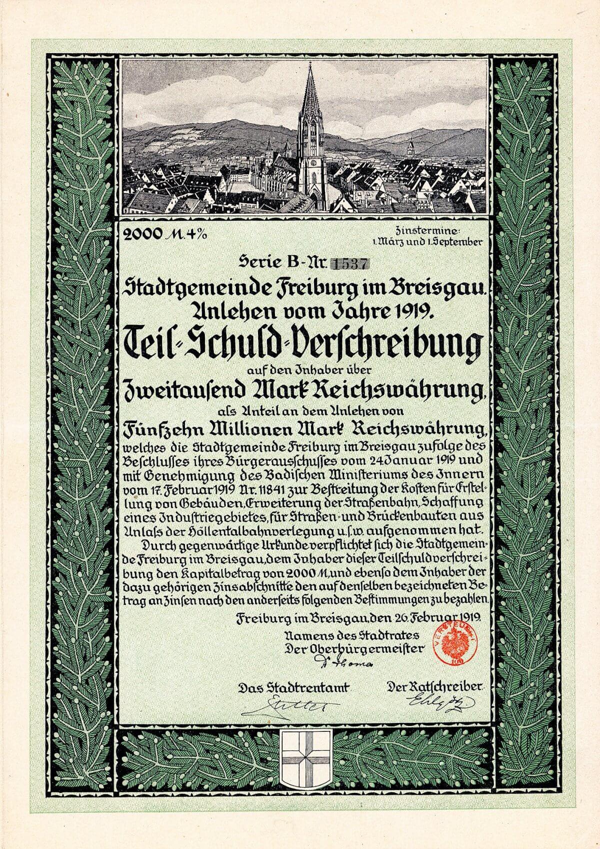 Stadt Freiburg im Breisgau, Teilschuldverschreibung über 2000 Mark von 1919. Teil einer Anleihe von 15 Millionen Mark für städtische Bauten, Erweiterung der Straßenbahn, Schaffung eines Industriegebietes sowie Straßen- und Brückenbauten aus Anlaß der Höllentalbahnverlegung.